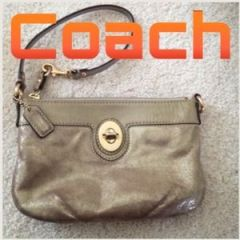 Love this cute silver Coach wristlet!