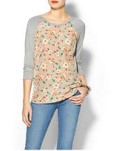 Floral patterns continue to be big this spring-love this casual but fun top!  $35